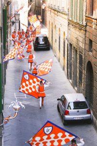 SamiM Adventures Palio horse race in Siena, Italy Leocorno Contrada Flag parade