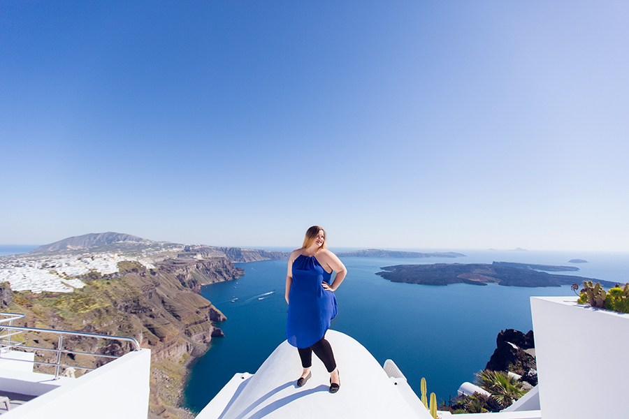 finding a photographer while traveling abroad Santorini Greece blue domes in oia